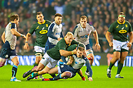 Finn Russell (#10) (Racing 92) of Scotland is flattened by Vincent Koch (#18) (Saracens) of South Africa during the Autumn Test match between Scotland and South Africa at the BT Murrayfield Stadium, Edinburgh, Scotland on 17 November 2018.
