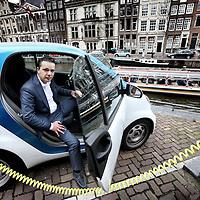 Nederland, Amsterdam , 19 april 2012..Mohamed el Maknouzi van Car2go..Elektrische ambities heeft Amsterdam altijd al in overvloede gehad, maar tot nu toe bleef het bij wat relatief kleine initiatieven. Vandaag heeft de hoofdstad echter een grote stap gezet met de presentatie van het Car2go project. Hierdoor is Amsterdam namelijk in één klap 300 elektrische Smarts rijker..Foto:Jean-Pierre Jans