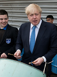 © Licensed to London News Pictures. 25/04/2013. London, UK. Mayor of London, Boris Johnson play on a steel pan among students during his visit Kingsley Academy in Hounslow, West London on 25th of April, 2013. Photo credit : Peter Kollanyi/LNP