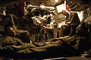 Exhausted from non stop fire missions, IDF artillery soldiers take a nap while waiting for another fire mission on Hizbullah targets. 2nd Lebanon War. Israel, August 2006.