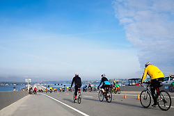 United States, Washington, Seattle. April 3, 2016. Bicyclists on the new Evergreen Point (State Route 520) floating bridge on the opening day of the new bridge. The new bridge is the longest, and widest, floating bridge in the world.