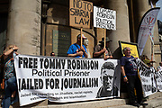 Free Tommy Robinson demonstrators gather across the road from their opposition organised by anti-fascist groups including Stand up to Racism opposed to far right politics on 24th August 2019 in London, United Kingdom. Some 250 Stand Up To Racism and other anti-fascist groups took to the streets today in opposition to supporters of jailed 'Tommy Robinson' real name Stephen Yaxley-Lennon at Oxford Circus, who gathered outside the BBC.