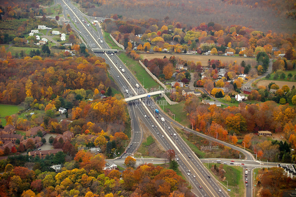 I-95 in Branford Connecticut. Aerial Photograph taken November 8, 2005 at peak autumn foliage. Construction progress image capture. Showing interchanges, overpasses and Amtrak rail right of way where applicable.