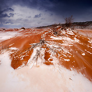 A winter storm begins to clear over Coral Pink Sand Dunes State Park near Kanab, Utah.