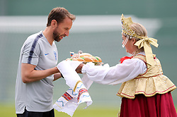 England manager Gareth Southgate receives a Russian karavai, a large round loaf of bread symbolizing hospitality during the training session at the Spartak Zelenogorsk Stadium, Repino.