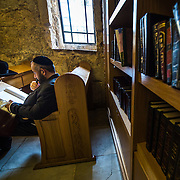 A Jew in deep study of a sacred book, probably the Torah.
