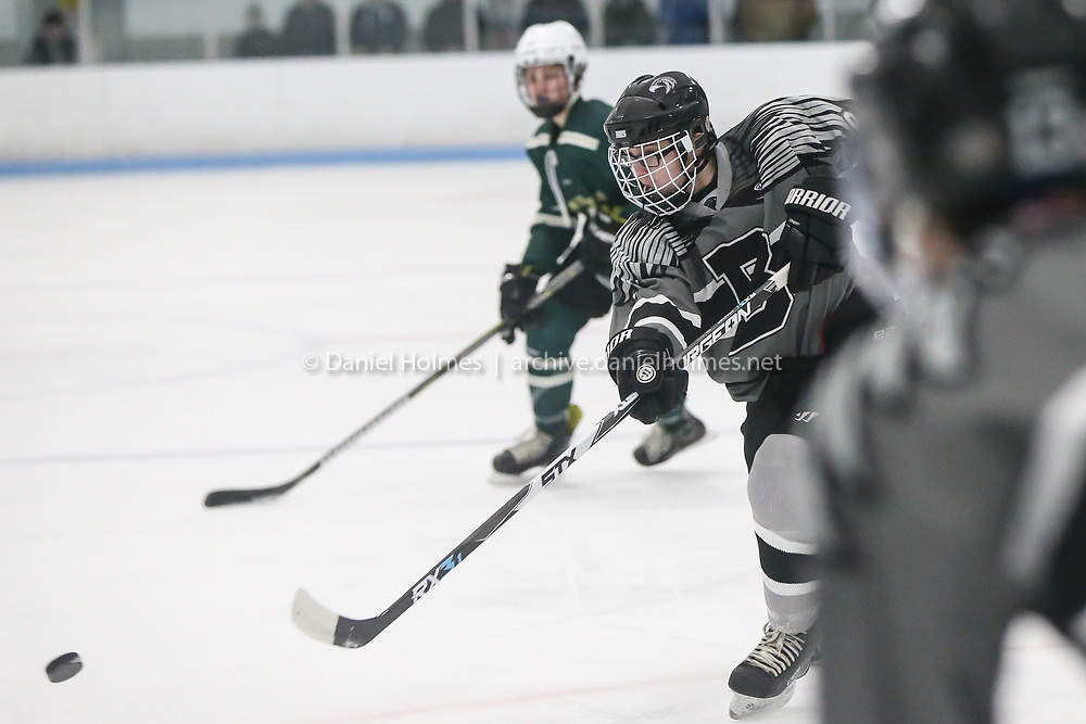 (12/26/19, FRANKLIN, MA) Bellingham's Shane Hamel takes a shot that is deflected during the championship game of the Bellingham Boosters Tournament hockey game against Nashoba Regional at Pirelli Veterans Arena in Franklin on Thursday. [Daily News and Wicked Local Photo/Dan Holmes]