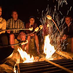 Around a camp fire near Perch Pond in Aroostook County, Maine. Deboullie Public Reserve Land.