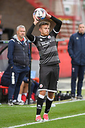 Crawley Town defender Archie Davies (15) takes a throw-in during the EFL Sky Bet League 2 match between Cheltenham Town and Crawley Town at Jonny Rocks Stadium, Cheltenham, England on 10 October 2020.