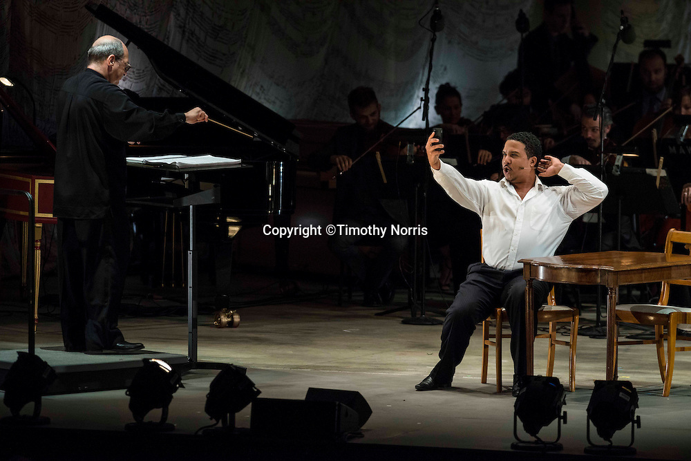 """Robert Spano, conductor and Aubrey Allicock (bass-baritone) as """"Tonic"""" in the world premiere of Steven Stucky and Jeremy Denk's The Classical Style: An Opera (of Sorts) at the 68th Ojai Music Festival at Libbey Bowl on June 13, 2014 in Ojai, California."""