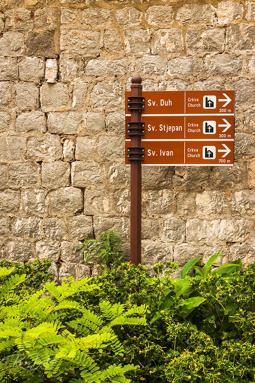 Street sign to local churches in Sudurad, Sipan Island, Dalmatian Coast, Croatia