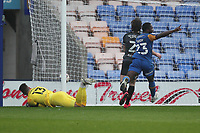 Shrewsbury Town's Nathanael Ogbeta scores his side's first goal  after his free kick deflected off the bar and onto Hull City's  keeper Matt Ingram the be given as a own goal<br /> <br /> Photographer Mick Walker/CameraSport<br /> <br /> The EFL League 1 - Shrewsbury Town v Hull City  - Saturday  20th March  2021 -  Montgomery Waters Meadow Stadium-Shrewsbury<br /> <br /> World Copyright © 2020 CameraSport. All rights reserved. 43 Linden Ave. Countesthorpe. Leicester. England. LE8 5PG - Tel: +44 (0) 116 277 4147 - admin@camerasport.com - www.camerasport.com