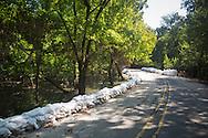 Sandbags along a road  in Spanish Lakes, Louisiana.