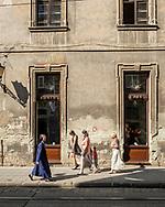 Lviv, Ukraine - September 4, 2016. Pedestrians walk outside a cafe in Lviv, Ukraine