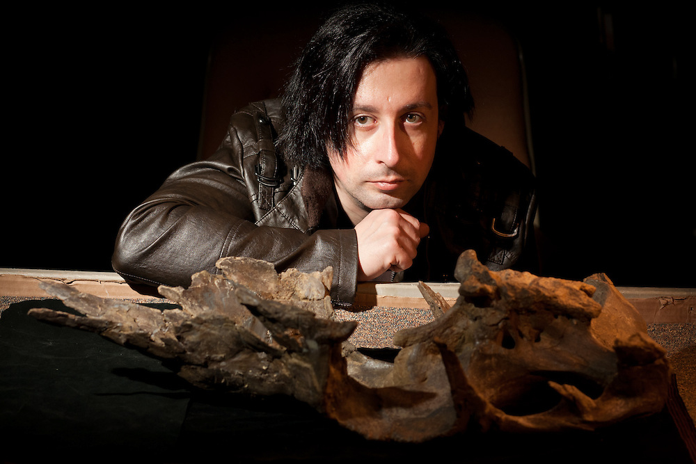 Albert Prieto-Marquez , Postdoctoral Fellow at the American Museum of Natural History in New York, stands next to a dinosaur skull found near Gallup New Mexico. Photographed at the New Mexico Museum of Natural History and Science on Jan. 4, 2011. ..((NOTE FOR EDITORS: Though he goes by Alberto, he prefers Albert in print. FYI)).