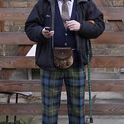 Man dressed in Scottish gear in Portobello Road, London