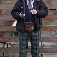 Man dressed in Scottish gear in Portobello Road, London