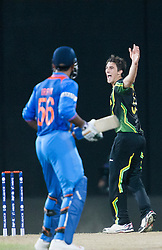 © Licensed to London News Pictures. 28/09/2012. Australian bowler Pat Cummins celebrates after getting the wicket of Virat Kohli during the T20 Cricket World cup match between Australia Vs India at the R.Premadasa Cricket Stadium,Colombo. Photo credit : Asanka Brendon Ratnayake/LNP