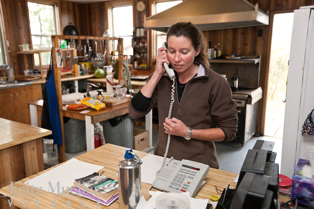 Sian Williams working in the old mess hall at the Kluane Lake Research Station, near Kluane National Park, Yukon