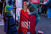 Prudence Salinas and her mother Amanda Ackerman play lawn games at at the AARP Block Party at the Albuquerque International Balloon Fiesta in Albuquerque New Mexico USA on Oct. 7th, 2018.