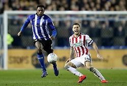 Sheffield Wednesday's Sam Hutchinson in action with Sheffield United's Billy Sharp