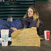 Homeless people sleeping on streets of Glasgow.  29 year old Pamela Murdoch from Wishaw has just woken up after spending the night sleeping  under the 'Hielanman's' umbrella on Argyle Street.  Pamela said she was help captive for 6 months by her violent partner and just escaped earlier this week. Someone stole her trainers and she is 3 months pregnant.<br /> <br /> Picture Robert Perry 17th March 2017<br /> <br /> Must credit photo to Robert Perry<br /> FEE PAYABLE FOR REPRO USE<br /> FEE PAYABLE FOR ALL INTERNET USE<br /> www.robertperry.co.uk<br /> NB -This image is not to be distributed without the prior consent of the copyright holder.<br /> in using this image you agree to abide by terms and conditions as stated in this caption.<br /> All monies payable to Robert Perry<br /> <br /> (PLEASE DO NOT REMOVE THIS CAPTION)<br /> This image is intended for Editorial use (e.g. news). Any commercial or promotional use requires additional clearance. <br /> Copyright 2014 All rights protected.<br /> first use only<br /> contact details<br /> Robert Perry     <br /> 07702 631 477<br /> robertperryphotos@gmail.com<br /> no internet usage without prior consent.         <br /> Robert Perry reserves the right to pursue unauthorised use of this image . If you violate my intellectual property you may be liable for  damages, loss of income, and profits you derive from the use of this image.