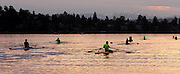 In the early easterly morning light, rowers navigate Westbound from Union Bay into the Montlake Cut.<br /> <br /> Greg Gilbert / The Seattle Times