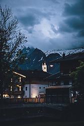 THEMENBILD - die beleuchtete Kirche und das mit Wolken verhangene Kitzsteinhorn, aufgenommen am 20. Mai 2020 in Kaprun, Österreich // the illuminated church and the Kitzsteinhorn covered with clouds, Kaprun, Austria on 2020/05/20. EXPA Pictures © 2020, PhotoCredit: EXPA/ JFK