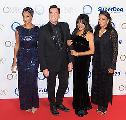 """Battersea, London, November 3rd 2016.  Celebrities and their dogs attend The Evolution at Battersea Park to attend The Battersea Dogs and Cats Home """"Collars and Coats Ball"""". PICTURED: Sister Sledge and Craig Revell-Horwood"""