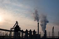 Trieste, La Ferriera di Servola e le sue immissioni nell'aria di polveri, fumi e altri inquinanti. Trieste, La Ferriera at Servola and its entries in the air of dust, fumes and other pollutants.