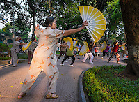 HANOI, VIETNAM - CIRCA SEPTEMBER 2014:  Vietnamese woman exercising early morning in the Hoan Kiem Lake, in Hanoi.