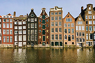 Dancing houses line the canals of Amsterdam, having settled far from straight in this city built on stilts.