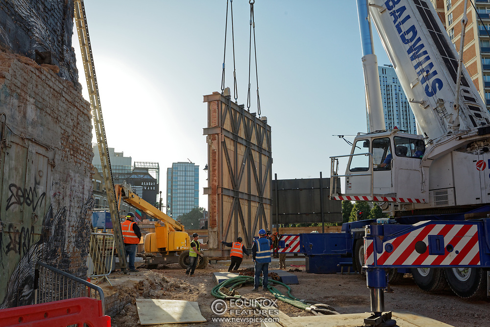 London, United Kingdom - 20 September 2019<br /> EXCLUSIVE SET - Aerial construction specialists and demolition experts use a huge crane to carefully lift intact, a twenty five ton, two-story wall, to preserve a famous Banksy rat image which has been covered up for years. Teams from specialist companies have spent over six weeks cutting around the artwork and fitting custom made eight ton steel supports to enable them to save the historic piece of art. Work has started on the construction of a new twenty seven floor art'otel hotel on the site of the old Foundry building in Shoreditch, east London, and a condition of the planning permission was to preserve the historical Banksy graffiti. A second section of the painting, an image of a TV being thrown through a broken window has already been cut out and moved separately. After the hotel construction is complete the two parts of the Banksy painting will be displayed on the hotel. Our pictures show the stages of work to protect the image, culminating in the lifting of the three story wall by crane. Video footage also available.<br /> (photo by: EQUINOXFEATURES.COM)<br /> Picture Data:<br /> Photographer: Equinox Features<br /> Copyright: ©2019 Equinox Licensing Ltd. +443700 780000<br /> Contact: Equinox Features<br /> Date Taken: 20190920<br /> Time Taken: 17154072<br /> www.newspics.com