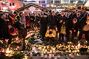 Visitors stand at the memorial on the day of commemorative events marking the first anniversary of the terrorist attack on Christmas market at Breitscheidplatz in Berlin, Germany, 19 December 2017. On 19 December 2016, Breitscheidplatz square in Berlin was the target of a terror attack in which 12 people lost their lives, when a truck driven by Anis Amri plowed through the Christmas market near the Kaiser-Wilhelm-Gedaechtniskirche (Kaiser Wilhelm Memorial Church).  EPA-EFE/OMER MESSINGER