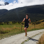 Competitors in action during the run leg of the Paradise Triathlon and Duathlon series with breathtaking views of Mount Aspiring National Park, Paradise, Glenorchy, South Island, New Zealand. 18th February 2012. Photo Tim Clayton