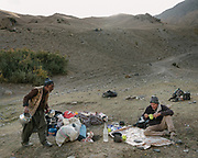 "Camping with Paul Salopek. Coming down from Daliz Pass (4260m) to a place name called Shaur, our first camp. Guiding and photographing Paul Salopek while trekking with 2 donkeys across the ""Roof of the World"", through the Afghan Pamir and Hindukush mountains, into Pakistan and the Karakoram mountains of the Greater Western Himalaya."