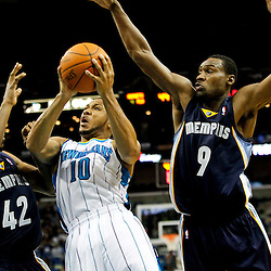 December 21, 2011; New Orleans, LA, USA; New Orleans Hornets shooting guard Eric Gordon (10) drives and shoots between Memphis Grizzlies power forward Walter Sharpe (42) and shooting guard Tony Allen (9) during the second quarter of a game at the New Orleans Arena.   Mandatory Credit: Derick E. Hingle-US PRESSWIRE
