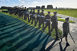 Soldiers from the Royal Artillery march off the guns at Stonehenge in Wiltshire, after firing 100 rounds on the 100th anniversary of the signing of the Armistice which marked the end of the First World War.