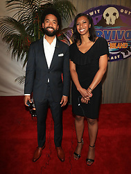 """Wendell Holland (L) - with Laurel Johnson - is crowned the winner of """"Survivor: Ghost Island"""" at the season 36 finale celebration held at CBS Television Studios in Los Angeles, CA."""