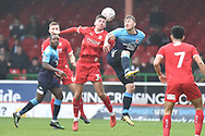 Woking forward Jake Hyde (9)  heads the ball  under pressure from Swindon Town midfielder Ellis Landolo (3) during the The FA Cup 2nd round match between Swindon Town and Woking at the County Ground, Swindon, England on 2 December 2018.