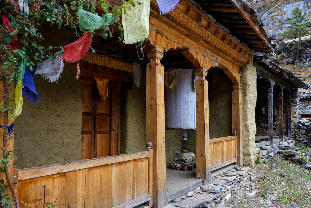 Prayer wheel on the porch of a Buddhist temple in the Tsum Valley of Nepal.