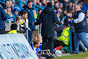 Oxford United forward Jamie Mackie (19) and Gillingham FC defender Connor Ogilvie (6) fall into the managers dugout during the EFL Sky Bet League 1 match between Gillingham and Oxford United at the MEMS Priestfield Stadium, Gillingham, England on 18 January 2020.