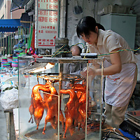 Asia, China, Chongqing. Local street market in the city of Chongqing, vendor with cooked duck.