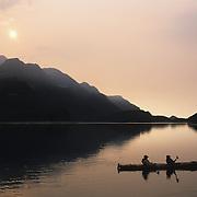 A pair of kayakers paddling in Geographic Harbor. Katmai National Park, Alaska