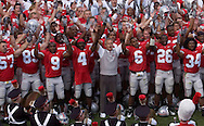 """MORNING JOURNAL/DAVID RICHARD<br />Ohio State head coach Jim Tressel and his squad sing """"Carmen Ohio"""" after yesterday's win over Miami."""