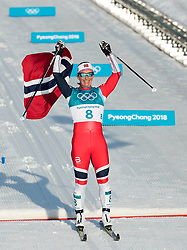 February 25, 2018 - Pyeongchang, South Korea - Marit Bjoergen of Norway celebrates winning the gold medal during the Ladies Cross Country Skiing Mass Start 30k at the PyeongChang 2018 Winter Olympic Games at Alpensia Cross-Country Skiing Centre on Sunday February 25, 2018. .Marit Bjoergen won the eighth gold medal of her career in the ladies' 30km mass start classic, the final event of the Games. After another multi-medal haul here, the illustrious veteran of five Games leaves PyeongChang as the most decorated Winter Olympian in history with a total of 15 medals: she has four silver and three bronze as well as her eight gold. (Credit Image: © Paul Kitagaki Jr. via ZUMA Wire)