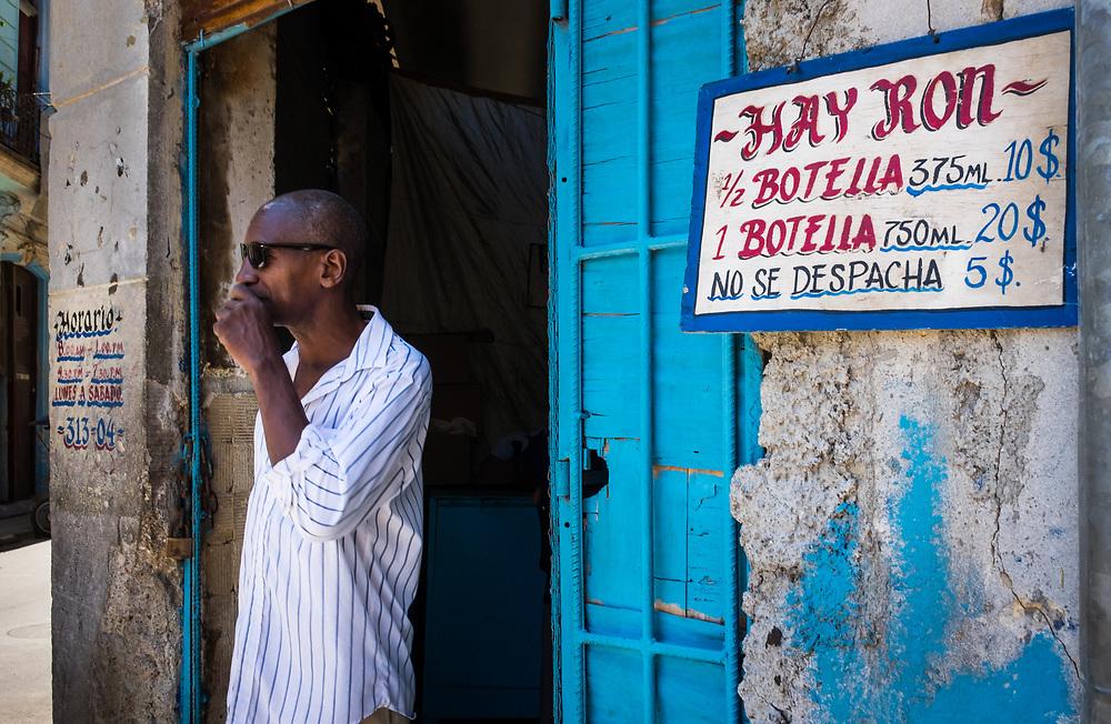 HAVANA, CUBA - CIRCA MAY 2016:  Man standing in front of shop in Centro Havana, Cuba.