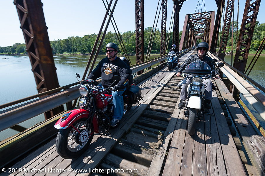Curtis Venable and Tom Banks (R) on the wooden Wabash Cannonball railroad bridge built in 1897 during the Cross Country Chase motorcycle endurance run from Sault Sainte Marie, MI to Key West, FL (for vintage bikes from 1930-1948). It was pretty as can be but the warped boards that formed the narrow tracks made some great stories for the rest of the trip. This was part of the 315 mile stage 4 ride from Urbana, IL to Bowling Green, KY USA. Monday, September 9, 2019. Photography ©2019 Michael Lichter.