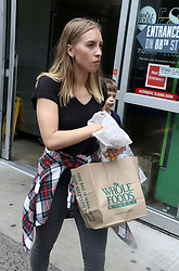 June 16, 2017 - New York, New York, U.S. - A customer holds a Whole Foods bag after purchasing groceries outside the Upper East Side 87th Street Whole Foods location. Amazon announced it planned to purchase Whole Foods for $13.4 billion. (Credit Image: © Nancy Kaszerman via ZUMA Wire)
