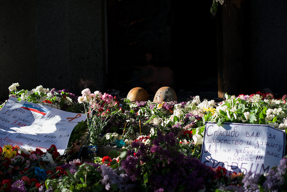 A shrine in memory of the people killed the day before, during deadly confrontations between armed separatist groups and the Ukrainian army took place throughout the city, can be seen at the entrance of Mariupol's police headquarters.